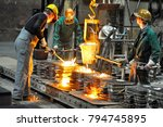 group of workers in a foundry... | Shutterstock . vector #794745895