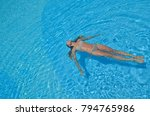 a girl relaxes in the swimming... | Shutterstock . vector #794765986