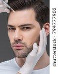 hands in medical gloves making... | Shutterstock . vector #794777902