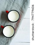 two mugs of milk on creased... | Shutterstock . vector #794779606