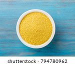 white bowl  with raw couscous... | Shutterstock . vector #794780962