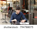 traveler purchasing tickets and ... | Shutterstock . vector #794788075
