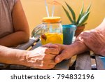 hand on hand for a senior... | Shutterstock . vector #794832196