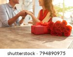 cheerful young couple sitting... | Shutterstock . vector #794890975