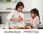 cute indian girl helping her... | Shutterstock . vector #794907316