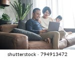 young asian family looking at... | Shutterstock . vector #794913472
