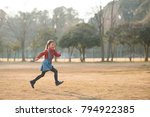 happy little girl running in... | Shutterstock . vector #794922385