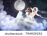 Small photo of A girl in the bedroom dressed as an airman or a pilot pretends to drive a paper airplane fly through the clouds and touch the stars and imagines she is flying free in the sky.