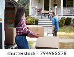 children helping unload boxes... | Shutterstock . vector #794983378