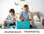 glad adolescent boys playing... | Shutterstock . vector #794994976