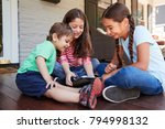 group of children sit on porch... | Shutterstock . vector #794998132
