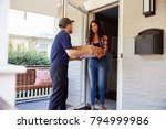 courier delivering package to... | Shutterstock . vector #794999986