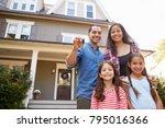 portrait of family holding keys ... | Shutterstock . vector #795016366