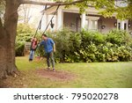 father pushing daughter on... | Shutterstock . vector #795020278
