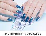 attractive manicure on women's... | Shutterstock . vector #795031588