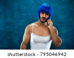 cute young man wearing blue wig ... | Shutterstock . vector #795046942