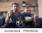 two guys watching football game ... | Shutterstock . vector #795058228