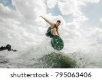 young caucasian surfer riding... | Shutterstock . vector #795063406