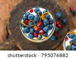 orange and blueberry yoghurt... | Shutterstock . vector #795076882