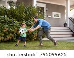 father playing soccer in garden ... | Shutterstock . vector #795099625