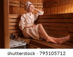 young woman sitting on wooden... | Shutterstock . vector #795105712