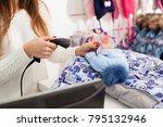 seller holding barcode scanner...   Shutterstock . vector #795132946