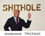 Small photo of NEW JERSEY, USA - JAN 13 2018: Caricature of US President Donald Trump pointing to a sign reading Shithole - a derogatory reference to countries whose people immigrate to the United States