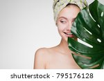 happy young girl with a towel... | Shutterstock . vector #795176128