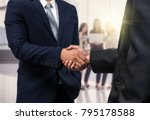 business shaking hands of... | Shutterstock . vector #795178588