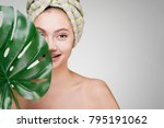 cute smiling girl with a towel... | Shutterstock . vector #795191062