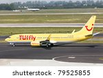 DUSSELDORF, GERMANY - MAY 21: Airplane Boeing 737-800 landed in Dusseldorf airport on May, 21 2011. TUIfly, with its fleet of 38 aircraft, is the third largest airline in Germany. - stock photo