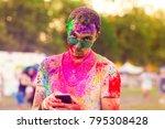guy celebrate holi festival | Shutterstock . vector #795308428