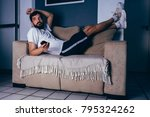 man wearing sportswear lying on ... | Shutterstock . vector #795324262