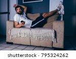 man wearing sportswear lying on ...   Shutterstock . vector #795324262