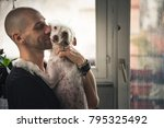 young man and his dog enjoying... | Shutterstock . vector #795325492