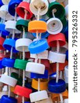 Small photo of Upcycled rattle; percusion instrument meant to be shaked. Made out of plastic bottle caps strung together. It is used by a professional percussionist in a Brazilian pop band.