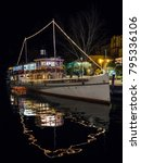 """Small photo of Riva del Garda, Italy - December 9, 2017: """"Giuseppe Zanardelli"""" is a wheeled motor vessel (ex steamship) sailing on the waters of Lake Garda, built in 1903."""
