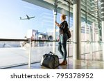 young casual female traveler at ... | Shutterstock . vector #795378952