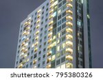 apartment windows at night for... | Shutterstock . vector #795380326