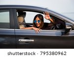 asian woman driving on the car... | Shutterstock . vector #795380962
