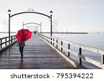 Woman Holding A Red Umbrella...