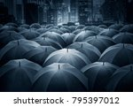 many of black umbrella in the... | Shutterstock . vector #795397012