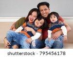 happy filipino man hugging his... | Shutterstock . vector #795456178