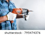 man with electric drill | Shutterstock . vector #795474376