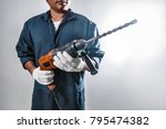 man with electric drill | Shutterstock . vector #795474382