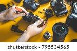 man hands repair broken film... | Shutterstock . vector #795534565