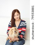 dachshund and young asian teens | Shutterstock . vector #79553881
