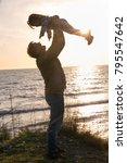 father with a baby girl at... | Shutterstock . vector #795547642