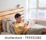 asian man using smartphone in... | Shutterstock . vector #795552382