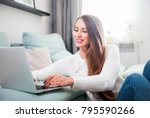 young woman at home using... | Shutterstock . vector #795590266